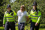 © Joel Goodman - 07973 332324 . No syndication permitted . 26/08/2013 . Bolton , UK . An EDL supporter is detained at the demonstration . The English Defence League hold a demonstration in Farnworth Park , Bolton , today (26th August 2013) . Photo credit : Joel Goodman