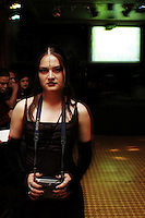 "A young woman poses for a portrait. ""Darkies"" or ""Goths"" at one of the Dada X parties in the historic center of Mexico City. August 28, 2005"