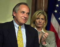 U.S. Senator Robert Torricelli (L) reacts to applause from supporters after he announced he is dropping out of the US Senate race, Monday, Sept. 30, 2002, in Trenton, New Jersey. (Photo by William Thomas Cain/photodx.com)