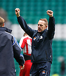 Kenny Shiels celebrates at the end to the away fans
