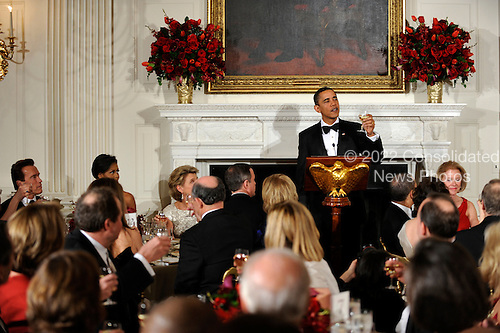 Washington, DC - February 22, 2009 -- United States President Barack Obama raises his glass in a toast as he welcomes the nation's governors to a black-tie dinner at the White House, Sunday, February 22, 2009.  The National Governors Association has been holding their 2009 Winter Meeting this weekend, where the nation's governors have been discussing Obama's stimulus program, as well as health care, infrastructure and education.    .Credit: Mike Theiler / Pool via CNP