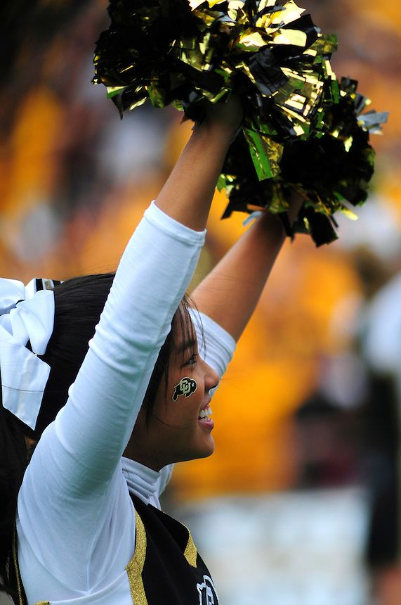 06 September 08: A Colorado cheerleader performs during a game against Eastern Washington. The Colorado Buffaloes defeated the Eastern Washington Eagles 31-24 at Folsom Field in Boulder, Colorado. FOR EDITORIAL USE ONLY