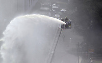 MEDELLIN, COLOMBIA - FEBRUARY 22: Firefighters spray water on the ruins of the Monaco building, which was once home to Colombian drug lord Pablo Escobar after its demolition in Medellin, Colombia on February 22, 2019. In its place will be erected a memorial to the victims of Escobar's reign of terror that ended when he was killed by police in 1993. (Photo by VIEWPRESS/ Fredy Builes)
