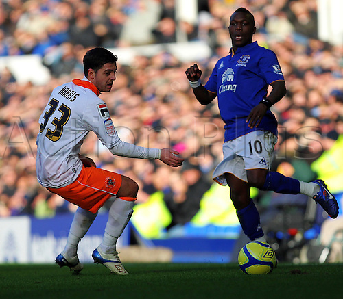 18.2.2012 Liverpool, England.  Everton Dutch Midfielder Royston Drenthe plays the ball past Harris of Blackpool during the Budweiser FA Cup match between Everton and Blackpool, played at Goodison Park. Everton won by a score of 2-0 to move into the 6th round.