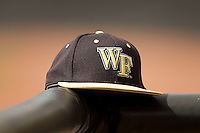 A Wake Forest Demon Deacons cap rests on the dugout railing during the game against the North Carolina State Wolfpack at Doak Field at Dail Park on March 17, 2012 in Raleigh, North Carolina.  The Wolfpack defeated the Demon Deacons 6-2.  (Brian Westerholt/Four Seam Images)