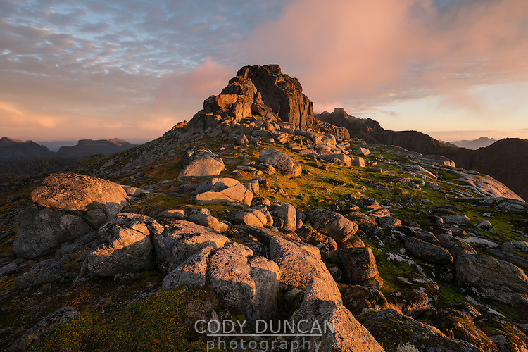 Rocky summit of Tønsåsheia at sunrise in autumn, Lofoten Islands, Norway