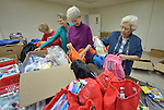 Volunteers assemble backpacks and bags of personal items for women and children who've been released from immigration detention facilities in Texas. The women have fled violence in Central America with their children and were detained by immigration authorities upon their arrival in the United States. After being released in San Antonio, they travel onward to stay with relatives elsewhere in the U.S., pending a final decision on their request for asylum. <br /> <br /> The backpacks and bags are assembled at El Divino Salvador United Methodist Church in San Antonio. The project is sponsored by the Interfaith Welcome Coalition. <br /> <br /> From left, the volunteers are Clyta Coder, a member of Laurel Heights United Methodist Church; Sally Lloyd, a member of University Presbyterian Church; Janice Clayton, a member of Laurel Heights United Methodist Church; and Sister Jo Murray, a Roman Catholic and member of the Holy Spirit Sisters.