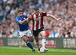 Jack O'Connell of Sheffield Utd tussles with David Davis of Birmingham City during the championship match at St Andrews Stadium, Birmingham. Picture date 21st April 2018. Picture credit should read: Simon Bellis/Sportimage