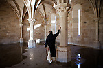 The New Clairvaux Abbot Paul Mark Schwan touches one of the 12th century stones used in their unfinished Chapter House at the monastery in Vina, Calif., January 2, 2013. The Chapter House is built from 12th century stones from the Chapter House of Ovila in Spain. Originally purchased by William Randolph Hearst, they were left abandoned in Golden Gate Park for over 60 years.