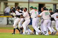 Clinton LumberKings outfielder Gaby Guerrero #27 (front) is mobbed by teammates including Patrick Kivlehan #47, Guillermo Pimentel #18, Janelfry Zorrilla #49 and Taylor Ard #35 after a walk off hit during a game against the Burlington Bees on May 23, 2013 at Ashford University Field in Clinton, Iowa.  Clinton defeated Burlington 6-5.  (Mike Janes/Four Seam Images)