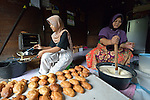 Zaitun and her daughter Nizria bake pastries in their home in Banda Aceh, on Indonesia's Sumatra Island. The family lost their house and belongings in the 2004 tsunami. The government provided them with a new house. Church World Service, a member of the ACT Alliance, loaned the women in the neighborhood the money they needed to purchase new equipment and ingredients to restart their businesses. The women repaid their loans to a revolving fund that they jointly manage. Zaitun has used the profits from her pastry business to keep her four children in school. Nizria recently graduated from a local university with a degree in economics, but while she's looking for employment she assists her mother with the pastry making.