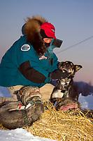 Veterinarian Jack Konitz checks over J.Kings dogs after arrival @ Ruby Chkpt 2006 Iditarod Alaska Winter