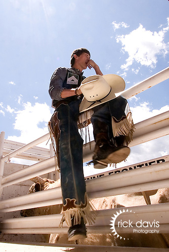 A PRCA cowboy awaits his pending bull ride during the annual Cheyenne Frontier Days Rodeo.