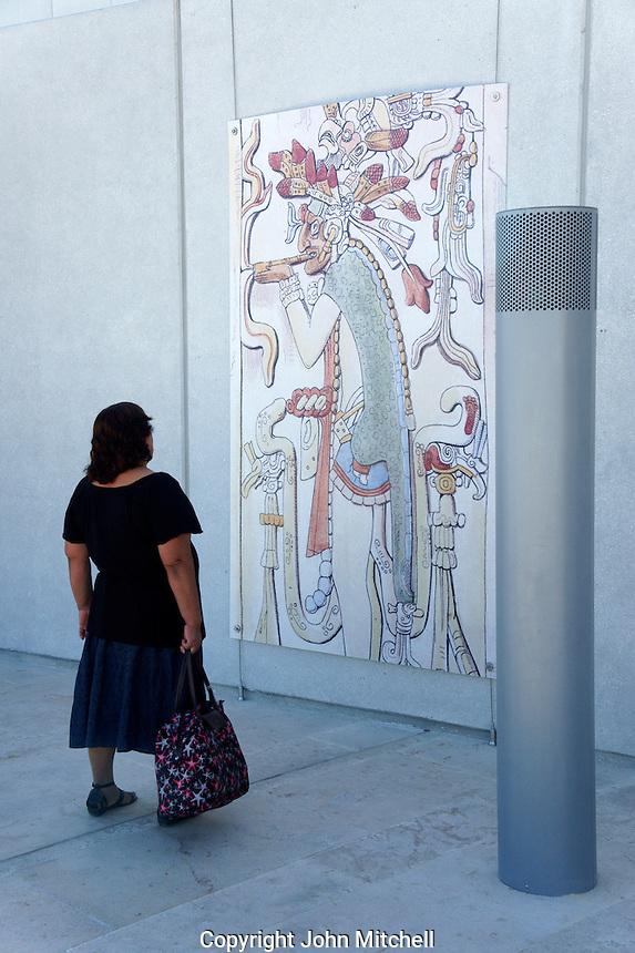Woman looking at Mayan mural, Gran Museo del Mundo Maya museum in Merida, Yucatan, Mexico      . .