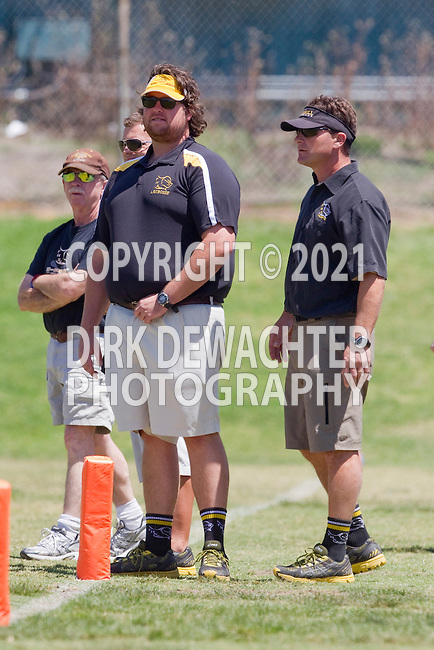 Santa Ana, CA 04/30/10 - The Foothill Santa Ana coaches, with Jon Fox on the right, watch the action on the field during the game against Rancho Bernardo.