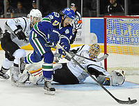 Utica Comets forward Kellan Lain, front, takes a shot on San Antonio Rampage goaltender Jacob Markstrom during an AHL hockey game, Monday, Jan. 13, 2014, in San Antonio. San Antonio won 3-2 in a shootout. (Darren Abate/AHL)