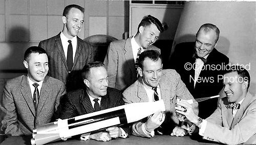 The Original 7 Mercury Astronauts are pictured around a table admiring an Atlas model on April 30, 1959. Standing, left to right are Alan B. Shepard, Jr., Walter M. Schirra, Jr., and John H. Glenn, Jr.; sitting, left to right are Virgil I. Grissom, M. Scott Carpenter, Donald Slayton, and L. Gordon Cooper, Jr. .Credit: NASA via CNP