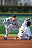 Jupiter Hammerheads shortstop Justin Bohn (13) tags out Adam Frazier (10) sliding in during a game against the Bradenton Marauders on June 25, 2014 at McKechnie Field in Bradenton, Florida.  Bradenton defeated Jupiter 11-0.  (Mike Janes/Four Seam Images)