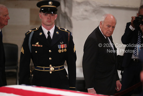 Former Vice President Dick Cheney walks past the casket of former President George H.W. Bush as it lies in state in the U.S. Capitol Rotunda in Washington, U.S., December 3, 2018. REUTERS/Jonathan Ernst/Pool