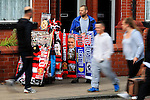 Manchester United fans walk past merchandise on sale outside the ground during the Premier League match at Old Trafford Stadium, Manchester. Picture date: September 24th, 2016. Pic Sportimage