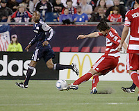 FC Dallas defender Heath Pearce(4) passes the ball.  The New England Revolution drew FC Dallas 1-1, at Gillette Stadium on May 1, 2010