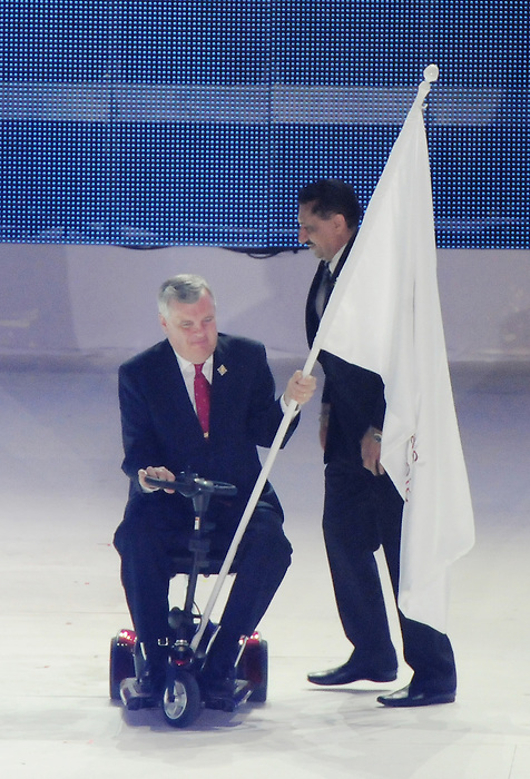 November 20 2011 - Guadalajara, Mexico:  Ontario's Lieutenant Governor Honorable David Onley receives the Americas Paralympic Committee flag from Minister of Sport Bal Gossal during Closing Ceremonies for the 2011 Parapan American Games at the Telmex Athletics Stadium in Guadalajara, Mexico.  Photos: Matthew Murnaghan/Canadian Paralympic Committee