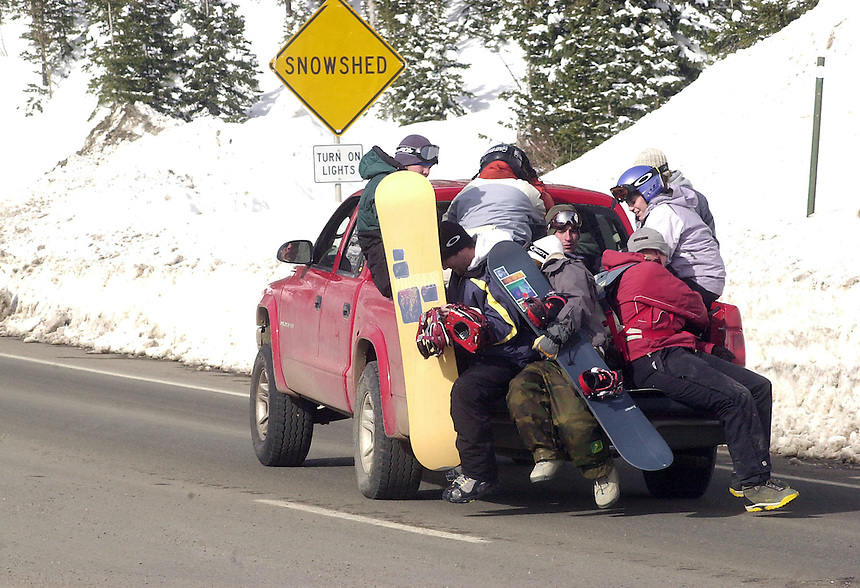 Snowboarders pile into the back of a pickup during a busy day at Wolf Creek Ski Area in southwestern colorado in November, 2003.