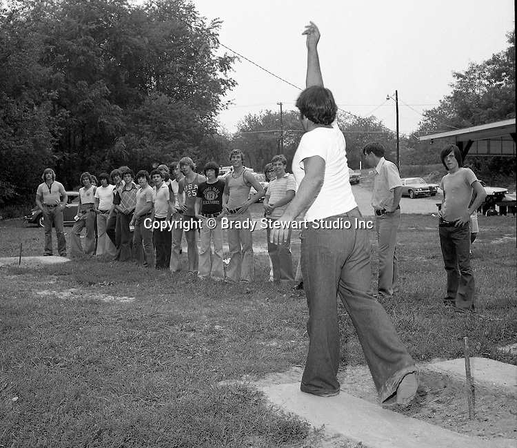 Bethel Park PA:  View of some of the members of the Bethel Park High School football team playing horseshoes during the annual Bethel Park Athletic Association picnic at Lyons Park.  <br />