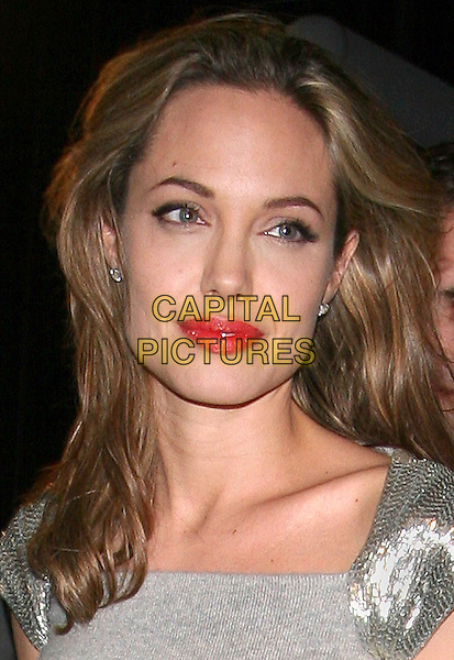 ANGELINA JOLIE.At the premiere of 'Peace One Day' held at Ziegfeld Theatre,.New York, 21st September 2005.portrait headshot grey gray red lips lipstick makeup.Ref: ADM/JL.www.capitalpictures.com.sales@capitalpictures.com.© Capital Pictures.