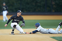 Patrick Frick (5) of the Wake Forest Demon Deacons waits for a throw as Zac Taylor (37) of the Illinois Fighting Illini steals second base at David F. Couch Ballpark on February 16, 2019 in  Winston-Salem, North Carolina.  The Fighting Illini defeated the Demon Deacons 5-2. (Brian Westerholt/Four Seam Images)