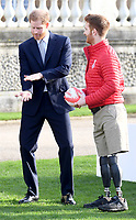 16/01/2020 - Prince Harry Duke of Sussex with England and Leeds Rhino wheelchair rugby league star James Simpson at the draw for the Rugby League World Cup 2021 where he met children from a local school at Buckingham Palace in London. Photo Credit: ALPR/AdMedia