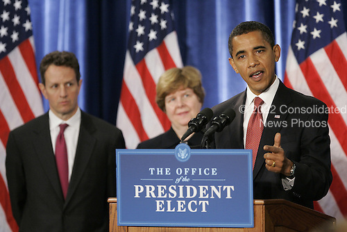 Chicago, IL - November 24, 2008 -- United States President-elect Barak Obama (R) takes questions from the press after introducing his economic team during a news conference on Monday, November 24, 2008 in Chicago. Obama named Treasury Secretary-designate Timothy Geithner, (L) and Council of Economic Advisers Chair-designate Christina Romer (C) as well as National Economic Council Director-designate Lawrence Summers and White House Domestic Policy Council Director-designate Melody Barnes, both not pictured. .Credit: Brian Kersey - Pool via CNP