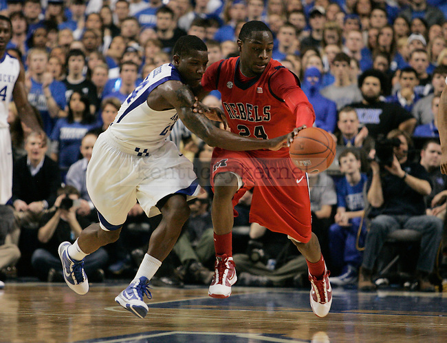 Freshman guard Eric Bledsoe fights for the ball in the first half of UK vs. Ole Miss at Rupp Arena on Tuesday, Feb. 3, 2010. Photo by Britney McIntosh | Staff