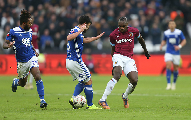 West Ham United's Michail Antonio and Birmingham City's Maxime Colin<br /> <br /> Photographer Rob Newell/CameraSport<br /> <br /> Emirates FA Cup Third Round - West Ham United v Birmingham City - Saturday 5th January 2019 - London Stadium - London<br />  <br /> World Copyright &copy; 2019 CameraSport. All rights reserved. 43 Linden Ave. Countesthorpe. Leicester. England. LE8 5PG - Tel: +44 (0) 116 277 4147 - admin@camerasport.com - www.camerasport.com