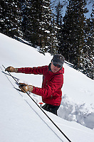 Colorado Avalanche Information Center (CAIC) Avalanche Forecaster Tim Brown (cq) measures out a square of snow to test snow pack at Coon Hill, which stands about 11,150 feet in elevation, and evaluate what type of avalanches may occur in similar regions around Summit County in Colorado, Thursday, February 16, 2012. Tests at this area showed that there was a fairly hard slab of snow resting on weaker snow beneath making conditions which can lead to avalanches...Photo by Matt Nager