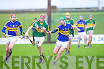 Kerry's Thomas Casey pulls away from Tipperary's Denis Maher and Paddy Murphy in the Waterford Crystal cup at Austin Stack park, Tralee on Sunday.