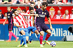 Sporting de Gijon's Lillo (l) and Nacho Cases (c) and FC Barcelona's Andre Gomes during La Liga match. September 24,2016. (ALTERPHOTOS/Acero)