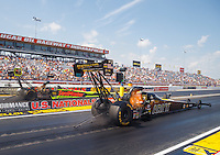 Sep 5, 2016; Clermont, IN, USA; NHRA top fuel driver Tony Schumacher (near) races alongside J.R. Todd during the US Nationals at Lucas Oil Raceway. Mandatory Credit: Mark J. Rebilas-USA TODAY Sports