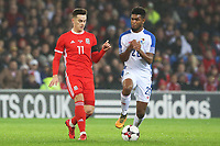Tom Lawrence of Wales is challenged by Ricardo Avila of Panama during the International Friendly match between Wales and Panama at The Cardiff City Stadium, Wales, UK. Tuesday 14 November 2017