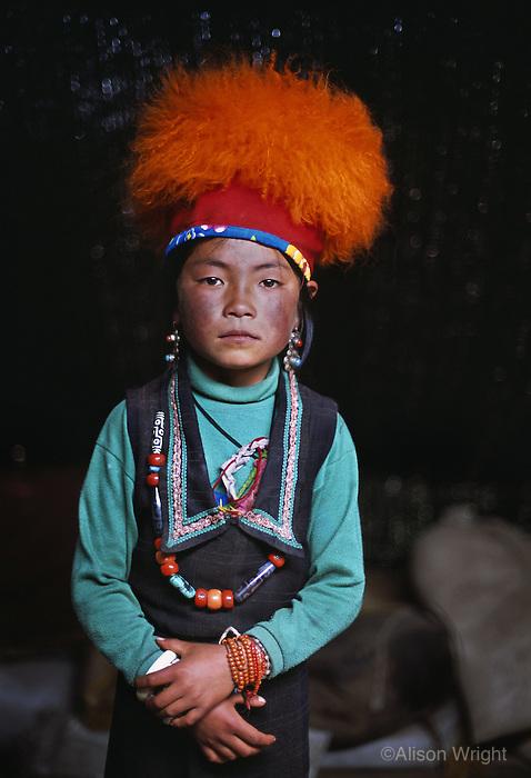 Tibet, Kham - Thuma Tibetan nomad girl in Degang Valley, near Litang, 2005.
