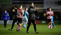 Lincoln City's assistant manager Nicky Cowley applauds the fans at the final whistle<br /> <br /> Photographer Chris Vaughan/CameraSport<br /> <br /> The EFL Sky Bet League Two - Lincoln City v Port Vale - Tuesday 1st January 2019 - Sincil Bank - Lincoln<br /> <br /> World Copyright © 2019 CameraSport. All rights reserved. 43 Linden Ave. Countesthorpe. Leicester. England. LE8 5PG - Tel: +44 (0) 116 277 4147 - admin@camerasport.com - www.camerasport.com