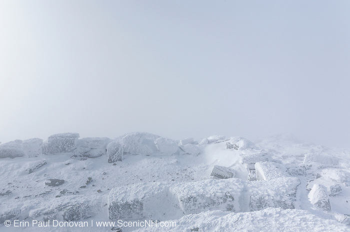 Appalachian Trail - Extreme weather conditions on the summit of Mount Lafayette during the winter months in the White Mountains, New Hampshire USA. Remnants of the old 1800s Summit House (foundation) is in the foreground.