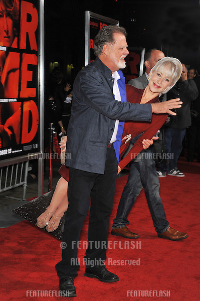 "Taylor Hackford with cutout model of his wife Helen Mirren at the premiere of her new movie ""Red"" at Grauman's Chinese Theatre, Hollywood..Helen was filming out of town and unable to attend the premiere..October 11, 2010  Los Angeles, CA.Picture: Paul Smith / Featureflash"