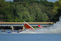 Frame 1: #37 Stacy Funk rolls over after contact with #31 Dan Schwartz (red and White boat with it's cowling in the air). Funk rolled completely over while it is speculated that Schwartz was knocked unconscious in the accident and accelerated across the river and crashed onto the golf course. In the later images of this series Schwartz can be seen emerging from behind Funk's boat. (SST-120 class)