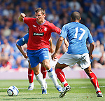 Lee McCulloch battling in midfield with the Portsmouth players