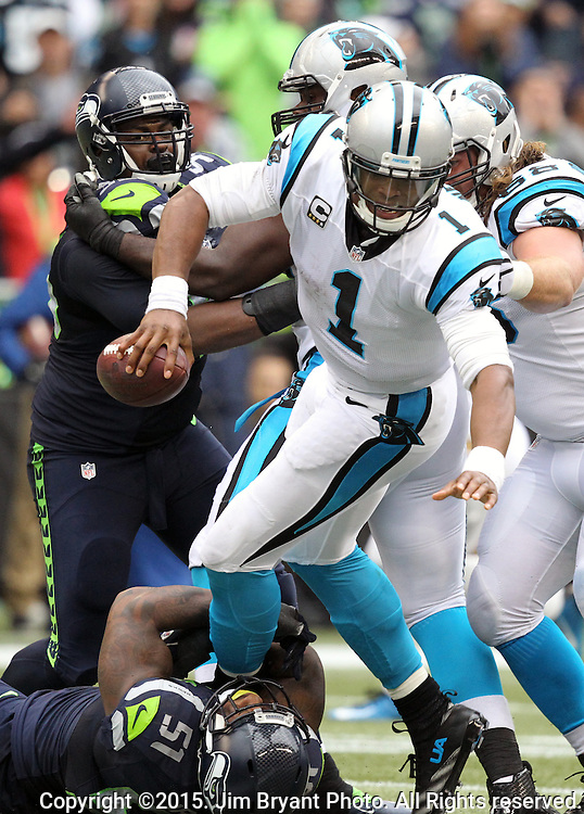 Seattle Seahawks linebacker Bruce Irvin (51) sacks Carolina Panthers Kam Newton (1) at CenturyLink Field in Seattle on October 18, 2015. The Panthers came from behind with 32 seconds remaining in the 4th Quarter to beat the Seahawks 27-23.  ©2015 Jim Bryant Photography. All Rights Reserved.