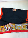 VINTAGE BAANTH WITH SUPERIORI KUTCH EMBROIDERY. THE ORANGE TRIMS HAVE BEEN ADDED RECENTLY. SIZE ABOUT 2 METRES. MAY BE WORN AS A STOLE, WRAP OR ODHNI.<br /> THE LONG BORDERS ARE GULMOHUR ORANGE AND THE SHORT BORDER IS RED.