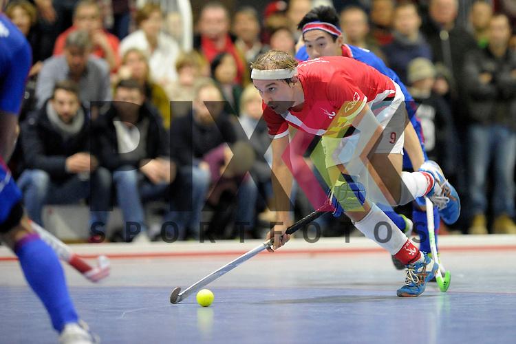 GER - Mannheim, Germany, January 10: During the 1. Bundesliga Sued Herren indoor hockey match between TSV Mannheim (red) and Mannheimer HC (blue) on January 10, 2016 at TSV Mannheim in Mannheim, Germany. Final score 5-9 (HT 3-7).  Maximilian Schulz-Linkholt #9 of TSV Mannheim<br /> <br /> Foto &copy; PIX-Sportfotos *** Foto ist honorarpflichtig! *** Auf Anfrage in hoeherer Qualitaet/Aufloesung. Belegexemplar erbeten. Veroeffentlichung ausschliesslich fuer journalistisch-publizistische Zwecke. For editorial use only.