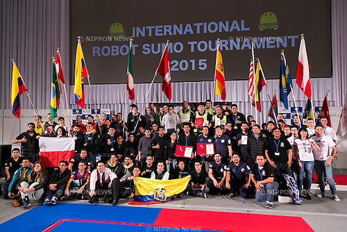Robot operators from 14 countries pose for the cameras at the International Robot Sumo Tournament 2015, in the Ryogoku Sumo Hall (Ryogoku Kokugikan) on December 13, 2015. The annual competition brings the winners from 14 robot sumo tournaments held globally, plus the Japanese winners of the All Japan Robot-Sumo National Tournament and All Japan Robot-Sumo Tournament (High-School class) to fight for the world's first place in two divisions: autonomous and radio controlled. The international tournament is part of the All Japan Robot-Sumo Tournament which has been held in various countries since 1989. According to the rules the robot wrestler loses when the robot is forced outside the sumo ring, simulating a traditional sumo fight. (Photo by Rodrigo Reyes Marin/AFLO)
