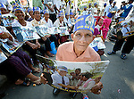 "People participate in a vigil outside a Phnom Penh court on December 14, 2012, during a hearing in which judges denied an appeal by Mam Sonando, a Cambodian radio journalist and human rights activist. Mam Sonando was sentenced in October 2012 to 20 years in prison for ""insurrection,"" despite local and international calls for his release."